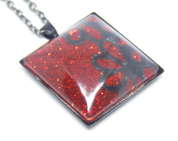 Black and Red Square Pendant Necklace. Lace effect over red glitter square on a black chain.