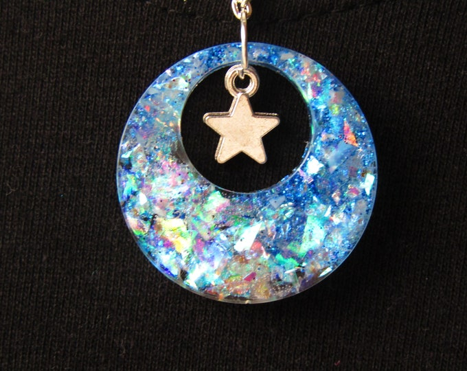 Sparkly blue and silver hoop winter necklace with star charm.