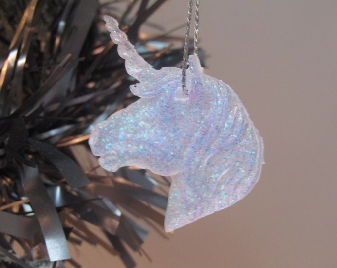 Pale lilac and white fairy unicorn. Christmas tree decoration.