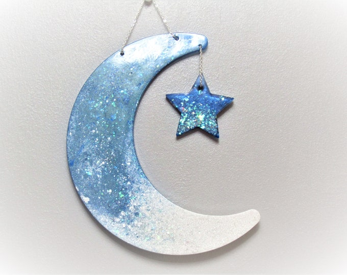 Moon and star wall hanging. Sparkly blue and white resin Christmas wall hanging.