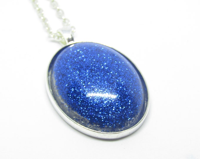 Blue glitter oval pendant necklace.