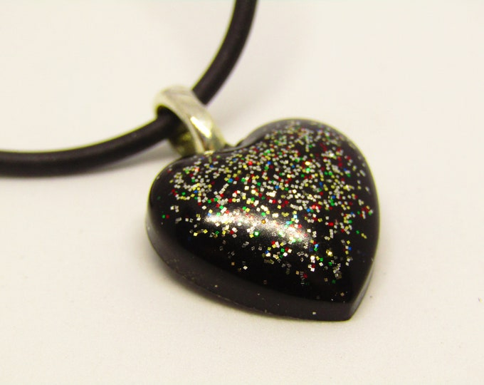 Small Black Sparkle Heart Resin Pendant. On a black cord.