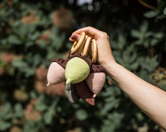Woodland acorn rattle baby gift from aunty to 6 month old wooden ring crochet rattle toy green crochet acorn with fabric leaves