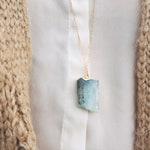 Aquamarine raw calcite pendant in golden brass