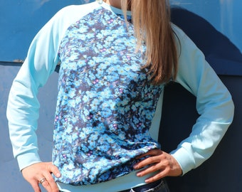Women sweatshirt with flowers. Forget-me-not