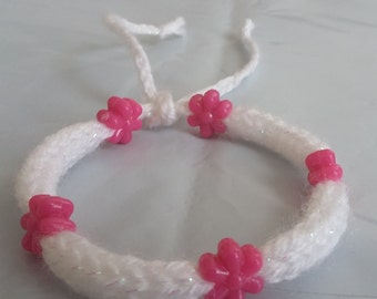 White Handmade Knitted Bracelet With Pink Flower Beads.