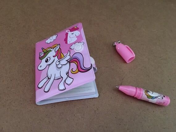 Mini unicorn notebook with pen