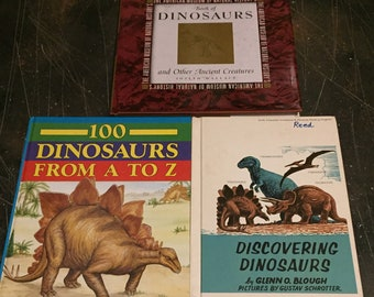 Set of vintage books: Book of Dinosaurs by Joseph Wallace, 100 Dinosaurs from A to Z by Ron Wilson and Discovering Dinosaurs by Glenn Blough