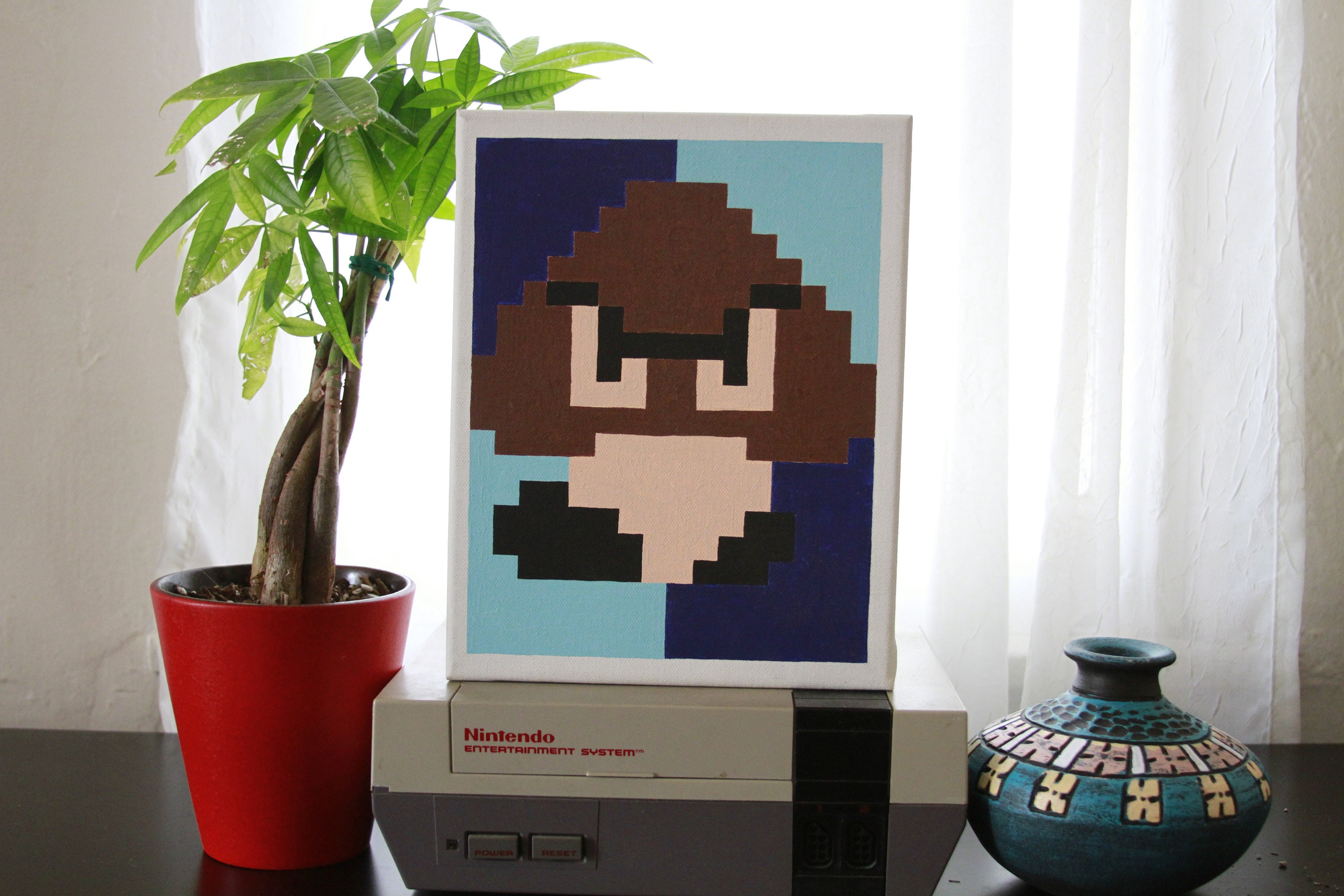 Pixel Painting Of A Goomba From Super Mario Bros