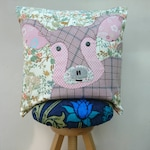 Pig cushion cover handmade applique using a mixture of recycled fabrics in pinks & florals
