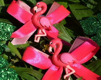 Pair of hair bows and pink flamingos