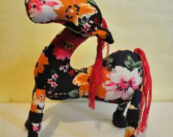 Colorful stuffed animal plushie horse