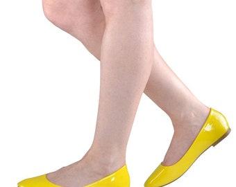 Yellow patent ballerina flats