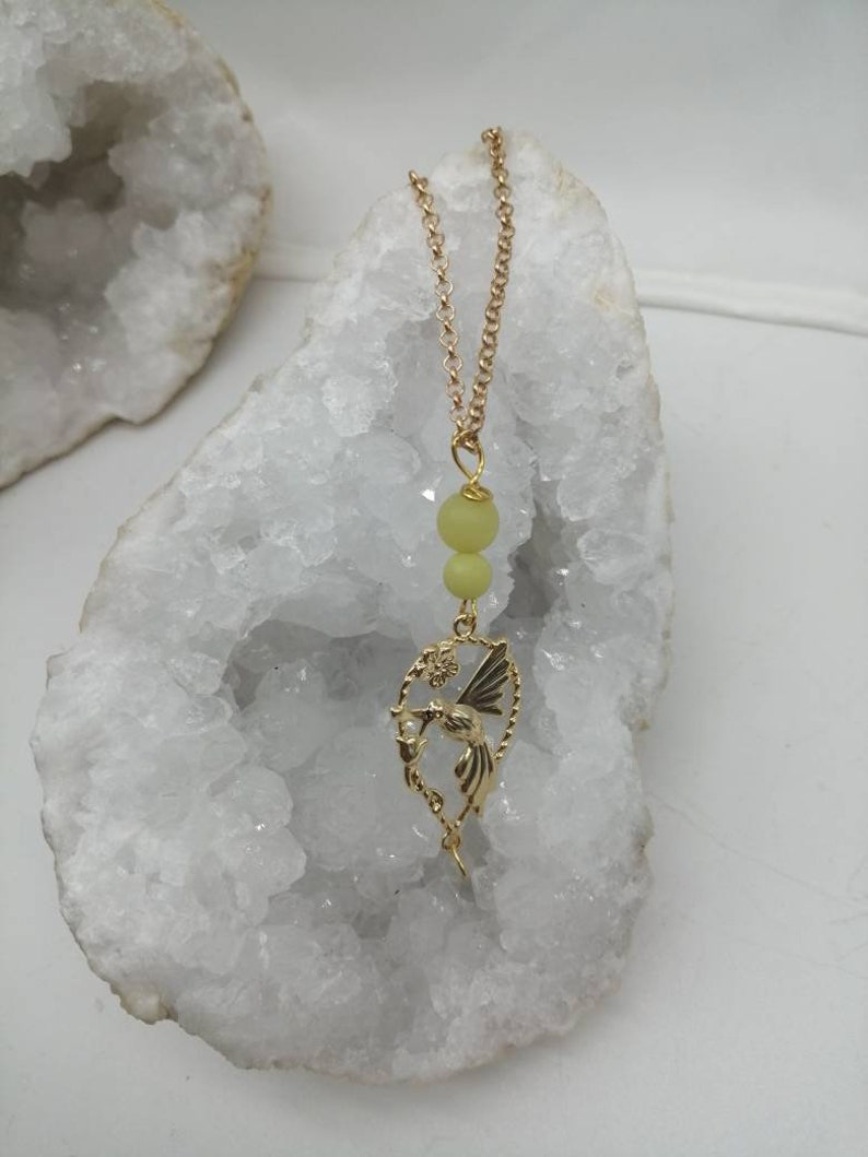 Magic Elf peripedot and white moonstone Earring available from 60 euros! gold-plated chain and gift box offered