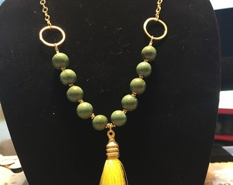 green dappled ceramic and gold necklace