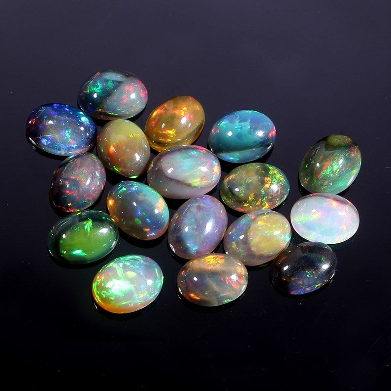 Loose Gemstone C7966 100/% Natural Ethiopian Black Dyed Fire Opal 6x8 mm Oval Cabochon 17 Pcs Lot 14.70 Cts