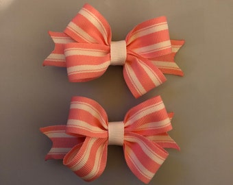 Pink and white striped pigtail hair bows