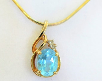 "Vintage Blue Topaz 8 X 6 mm Oval Pendant,Classic Fine necklace w/ 2 diamond accents,Pretty 3/4 "" gold swirl setting and 18"" gold snake chain"