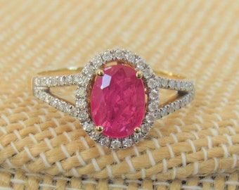 Ruby and Diamond Ring 14K Gold, Size 7 Luxurious Oval 1 carat Ruby, 1/4 carats in diamonds Excellent Quality, Split Shank covered diamonds.