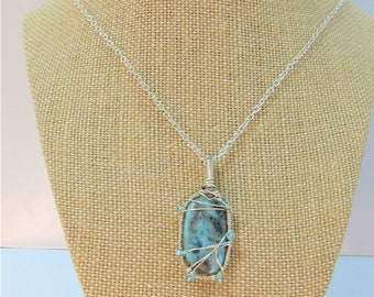 Larimar Oval pendant w/ 6 faceted 3mm sparkling Aquamarine beads, hand wired in Sterling Silver wrapped frame, Sterling Cable Chain included
