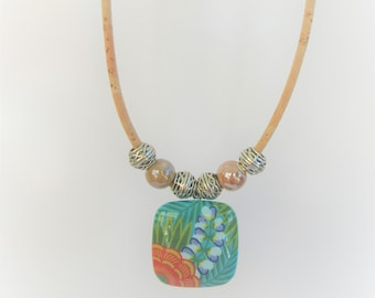 "Cork Necklace with Tropical Turquoise charm, 18"" long 3 mm cork, with 1.25 jungle charm and opalescent slider beads, lobster claw closure"
