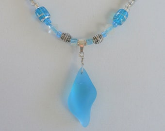 """Sea glass shell pendant,20"""" blue silver wired wrapped on glass beaded necklace of aqua blue, silver, clear glass beads, silver toggle clasp"""