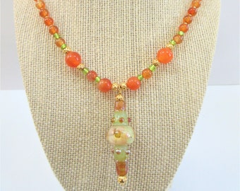 Lamp work glass,Carnelian Necklace,Floral Bead drop,Gemstone Necklace,Hand blown glass,carnelian,14K gold beads,Green Glass,Orange Gem Stone