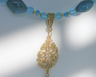 Blue bead necklace,Sea Treasure,blue glass,4 clay porcelain beads,gold spacers,gold crystal encrusted coral crystal Drop,lobster closure