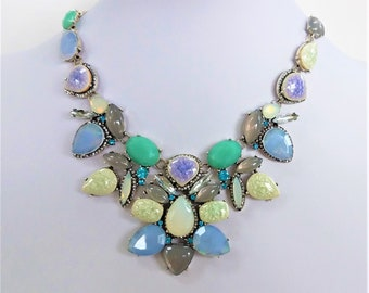 Reduced! Vintage Lori Goldstein LOGO bib necklace,aqua white silver,w/ crystal encrusted NK, never been worn,opal like stones.original box