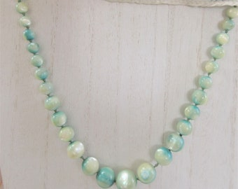 Vintage Variegated mother of pearl beads Necklace, teal tinted pearl beads,gold clasp. ends restrung, Cream (not yellow)with teal staining