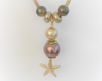 "Gold Starfish Necklace with Pearls, Pearlized slider beads,and starfish,18"" long,3 mm cork pendant, 3"" Pearl charms, lobster claw closure"