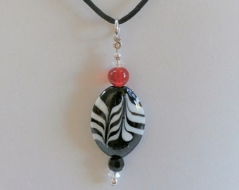 Bead pendant,Zebra Glass and black lamp work bead, with cut crystal black and red beads, w black silk cord