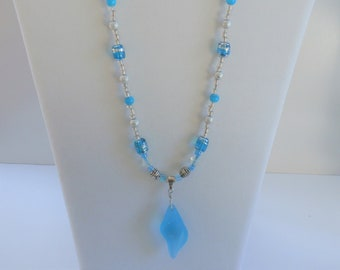 "Sea glass shell pendant,20"" blue silver wired wrapped on glass beaded necklace of aqua blue, silver, clear glass beads, silver toggle clasp"