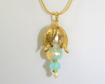 Shades of Aqua and Gold Sea Lantern Pendants and Earrings to Match,Stacks of faceted beads & Pearls,Gold Earwires, Snake chains, Rings,Clasp