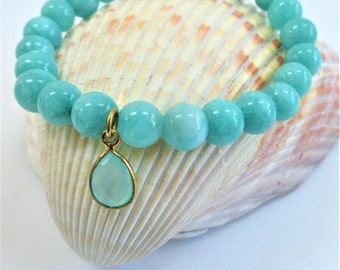 "Aqua Quartzite Stretch bracelet; round 8mm beads, pear-shaped bezel-set chalcedony charm, Average 7-1/4"" Fit Charm measures 5/8""L x 1/4""W"