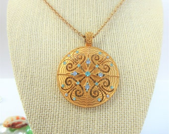 Vintage chain with Vintage 2 inch circle enhancer pendant with aqua crystals set into carved and laser cut gold metal.