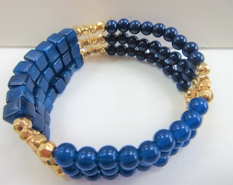 Blue Bead Stretch Bracelet, 3 rows of blue beads w gold beads and gold separator.Light Blue and dark blue round beads,blue cube beads