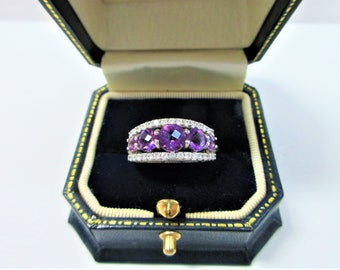 Judith Ripka Sterling 7 Gemstones Amethyst Ring,5+ carats of deep Purple ,CZ stone set along both sides, Size 7,Vintage,Excellent Condition
