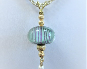 Floral Lamp Work Bead Pendant,Teal Purple Stripes Clear Glass Blown 20 mm Bead, Gold Plated Corrugated Beads,Wire bail,& chain and pearl