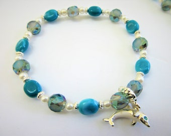 Blue Aurora Bead Bracelet,Crystal &  pearl,silver spacers, turquoise marbled beads, stretch bracelet,silver dolphin charm, blue crystal eyes