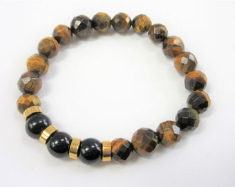 Unisex Beaded Stretch Bracelet, 9.5 inch fitted, 8 mm faceted tigers eye agates, with 3 black onyx beads, gold plated ring spacers