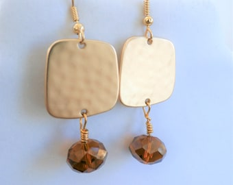 Hammered gold square earrings with faceted drop amber bronze crystal,on a gold fish hook earwire. All hand wired with 14k gold plated wires.