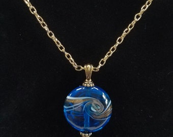 "Blue Glass Necklace - Gorgeous Ocean Blue,Gold,White Lamp-work 1.25"" Bead Pendant,with gold bail and 18"" chain, Lobster claw closure"