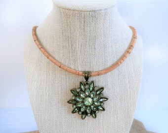 "Natural gold flecked cork 22 "" necklace, with 2 inch green glass starburst medallion, set in brass with gold lobster claw, hand crafted cork"
