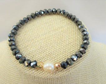 Faceted Hematite Crystal, Pearl and 14k gold bead stretch bracelet, Designer 7 mm charcoal beads with 11 mm pearl and gold beads bracelet