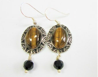 Sterling and Tigers Eye Oval Earrings,Genuine Tigers Eye cabochon set into design framed oval, black accent faceted crystal,Sterling Silver