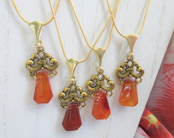 "Carnelian carved 20mm pendant,on 18"" gold filled chain with 2 inch ext., wired onto decorative connector of Gold plate Brass. 14K gold bail"
