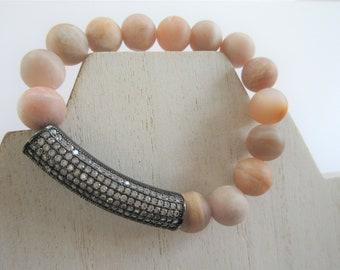 "Sunstone feldspar Bracelet,genuine 10 mm 14 bead stretch Bracelet,w gun metal crystal long tube bead, size small, 7"" fitted, polished smooth"
