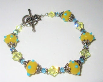 Yellow Blue Lampwork Glass bead Bracelet, 8 inch of Blue and Yellow Cut Crystals, Sterling Silver spacers,gorgeous toggle/Ring,one of a kind