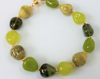 "Green Polished Stone Bracelet,8"",  small 14k gold beads, magnet closure. Every bead different, high quality Smooth gemstone,Comfortable too."